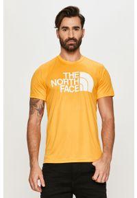 Pomarańczowy t-shirt The North Face z nadrukiem