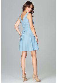 Niebieska sukienka na wesele Katrus z kokardą, elegancka