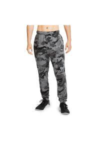 Spodnie treningowe męskie Nike Dri-FIT CU6200. Materiał: bawełna, dzianina, materiał, skóra, poliester. Technologia: Dri-Fit (Nike). Sport: fitness