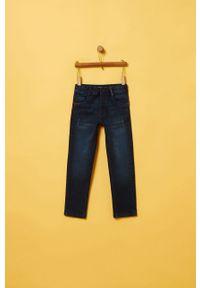Niebieskie jeansy OVS w kolorowe wzory