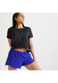 DOMYOS - Koszulka fitness Domyos Crop top krótki rękaw. Kolor: biały, czarny, wielokolorowy. Materiał: poliester, elastan, materiał. Długość rękawa: krótki rękaw. Długość: krótkie. Sport: fitness