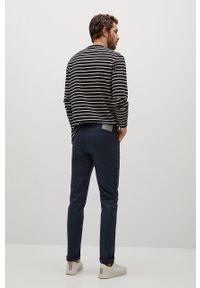 Mango Man - Spodnie PISA. Kolor: niebieski. Materiał: dzianina, bawełna. Wzór: gładki