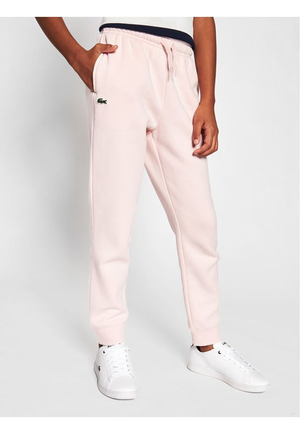 Lacoste Spodnie dresowe XJ9476 Różowy Regular Fit. Kolor: różowy. Materiał: dresówka