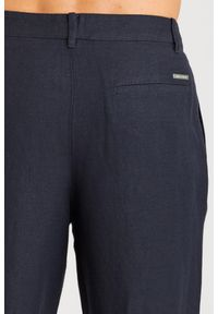 Niebieskie spodnie Armani Exchange z aplikacjami