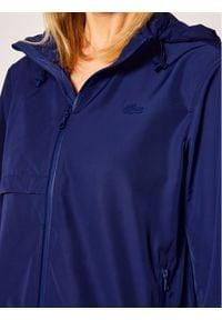 Lacoste Kurtka przeciwdeszczowa BF4519 Niebieski Regular Fit. Kolor: niebieski