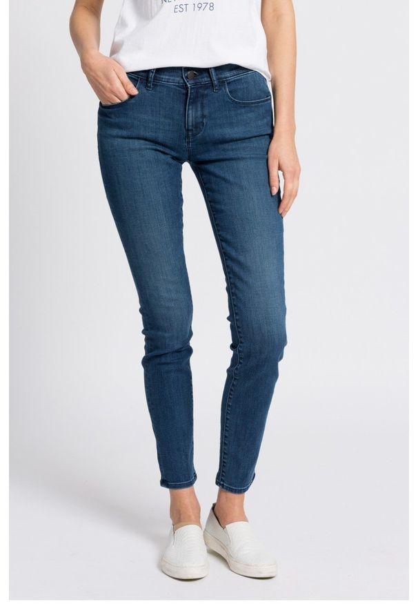 Niebieskie jeansy Calvin Klein Jeans w kolorowe wzory