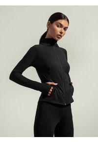 4f - Bluza treningowa rozpinana bez kaptura damska Anna Lewandowska x 4F. Typ kołnierza: bez kaptura. Kolor: czarny. Materiał: dzianina