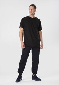 Niebieskie spodnie dresowe Born2be #6