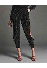 RETROFETE - Spodnie dresowe z kryształami Ariana. Kolor: czarny. Materiał: dresówka. Wzór: aplikacja