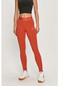 Czerwone legginsy Adidas gładkie