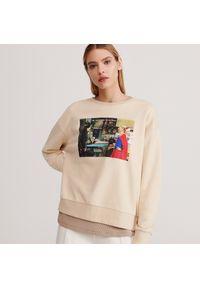 Kremowa bluza Reserved z nadrukiem