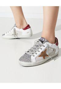 GOLDEN GOOSE - Białe sneakersy z brokatem Superstar. Nosek buta: okrągły. Kolor: biały. Materiał: bawełna, tkanina, guma. Wzór: gładki, aplikacja