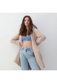 Różowy sweter Reserved długi, z kapturem