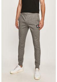 Szare spodnie dresowe TOMMY HILFIGER z aplikacjami