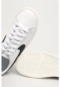 Białe buty sportowe Nike Kids z okrągłym noskiem, na sznurówki
