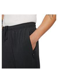 Spodnie legginsy męskie do biegania Nike Dri-FIT UV Challenger DD4978. Materiał: tkanina, skóra, materiał, poliester. Technologia: Dri-Fit (Nike)