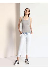 Niebieskie spodnie DRYWASH w kolorowe wzory, eleganckie, długie
