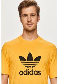 Pomarańczowy t-shirt adidas Originals casualowy, na co dzień, z okrągłym kołnierzem