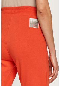 Czerwone spodnie dresowe Armani Exchange