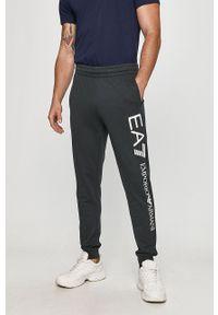 Niebieskie spodnie dresowe EA7 Emporio Armani z nadrukiem