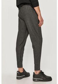 Szare spodnie dresowe Nike gładkie