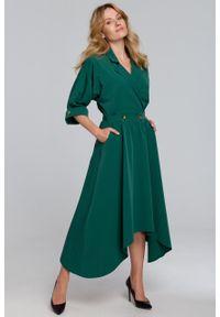 e-margeritka - Sukienka rozkloszowana midi elegancka zielona - s. Kolor: zielony. Materiał: tkanina, poliester, materiał, elastan. Wzór: gładki. Typ sukienki: asymetryczne, kopertowe, rozkloszowane. Styl: elegancki. Długość: midi