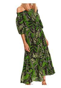 TOP SECRET - Długa sukienka z odkrytymi ramionami w nadruk w liście. Kolor: zielony. Materiał: dzianina. Wzór: nadruk. Sezon: lato. Typ sukienki: z odkrytymi ramionami. Styl: wakacyjny. Długość: maxi
