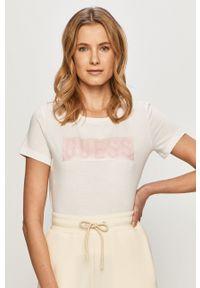 Guess - T-shirt. Okazja: na co dzień. Kolor: biały. Wzór: nadruk. Styl: casual