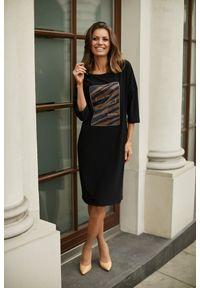 e-margeritka - Sukienka luźna elegancka czarna - 46. Okazja: do pracy, na co dzień. Kolor: czarny. Materiał: poliester, wiskoza, materiał, elastan. Wzór: aplikacja. Typ sukienki: proste. Styl: elegancki. Długość: midi