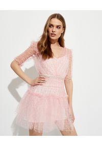 SELF PORTRAIT - Różowa sukienka mini w kropki. Kolor: różowy, wielokolorowy, fioletowy. Materiał: tkanina. Wzór: kropki. Typ sukienki: rozkloszowane, dopasowane. Długość: mini