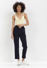 Born2be - Granatowe Spodnie Phrixetis. Okazja: na co dzień. Kolor: niebieski. Materiał: tkanina, lakier. Długość: długie. Wzór: jednolity. Styl: klasyczny, elegancki, casual