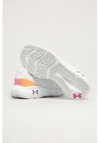 Białe buty sportowe Under Armour na obcasie, z cholewką