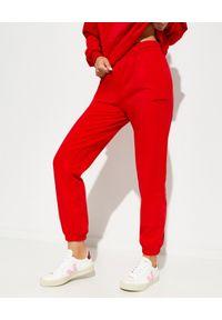 LA MANIA - Dresowe spodnie Banta. Kolor: czerwony. Materiał: dresówka. Wzór: napisy