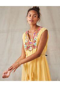 Żółta sukienka z haftami, midi