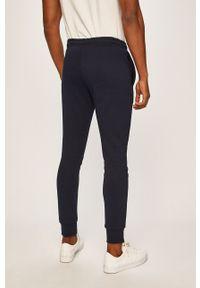 Lacoste - Spodnie XH9507. Kolor: niebieski. Materiał: materiał, bawełna, dzianina, poliester, elastan. Wzór: gładki #3