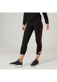 DOMYOS - Legginsy 7/8 fitness. Kolor: czarny, czerwony, wielokolorowy. Materiał: skóra, włókno, bawełna, materiał. Wzór: ze splotem. Sport: fitness