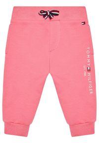 TOMMY HILFIGER - Tommy Hilfiger Spodnie dresowe Baby Essential KN0KN01281 Różowy Regular Fit. Kolor: różowy. Materiał: dresówka