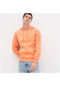 Pomarańczowa bluza House z kapturem
