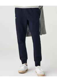 Lacoste - LACOSTE - Granatowe spodnie dresowe Sport Tennis. Kolor: niebieski. Materiał: dresówka. Wzór: haft