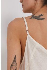 DKNY - Dkny - Sukienka. Okazja: na co dzień. Kolor: beżowy. Materiał: tkanina. Długość rękawa: na ramiączkach. Wzór: gładki. Typ sukienki: proste. Styl: casual