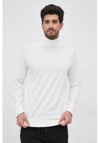 Karl Lagerfeld - Longsleeve bawełniany. Okazja: na co dzień. Typ kołnierza: golf. Kolor: beżowy. Materiał: bawełna. Długość rękawa: długi rękaw. Wzór: nadruk. Styl: casual
