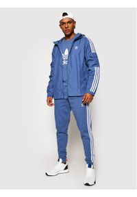 Adidas - adidas Wiatrówka adicolor Classics 3-Stripes GN3469 Niebieski Regular Fit. Kolor: niebieski