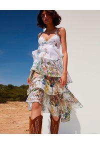 CHARO RUIZ IBIZA - Sukienka z falbanami Joyce. Kolor: biały. Materiał: bawełna. Długość rękawa: na ramiączkach. Wzór: kwiaty, aplikacja, geometria, nadruk. Typ sukienki: asymetryczne. Długość: midi