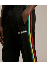 PALM ANGELS - Czarne spodnie dresowe Exodus. Kolor: czarny. Materiał: dresówka. Wzór: kolorowy, aplikacja