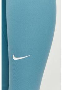 Nike - Legginsy. Stan: podwyższony. Kolor: niebieski. Materiał: tkanina, dzianina, poliester, elastan, włókno, skóra. Wzór: gładki #2