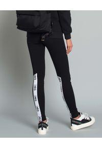 DSG - Leginsy z logo marki. Okazja: na co dzień. Kolor: czarny. Materiał: materiał. Styl: elegancki, casual, sportowy