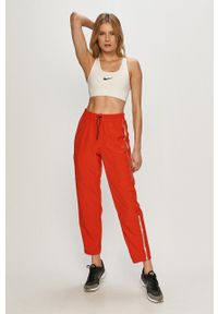Nike - Spodnie. Kolor: czerwony