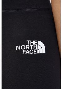 The North Face - Legginsy. Kolor: czarny. Materiał: dzianina. Wzór: nadruk