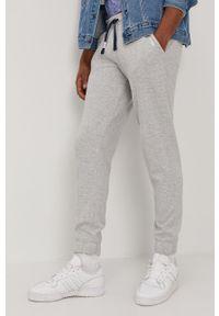 Tommy Jeans - Spodnie. Kolor: szary. Materiał: bawełna. Wzór: aplikacja