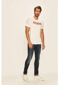 Biały t-shirt Guess Jeans z aplikacjami, z okrągłym kołnierzem